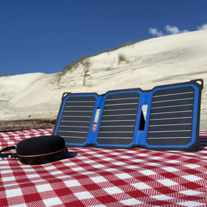 SunSaver Super Flex, 14-Watt Solar Charger on the beach. And charging a speaker.