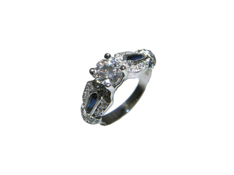 0.48ct Round Brilliant Cut Diamond with Sapphire Accents