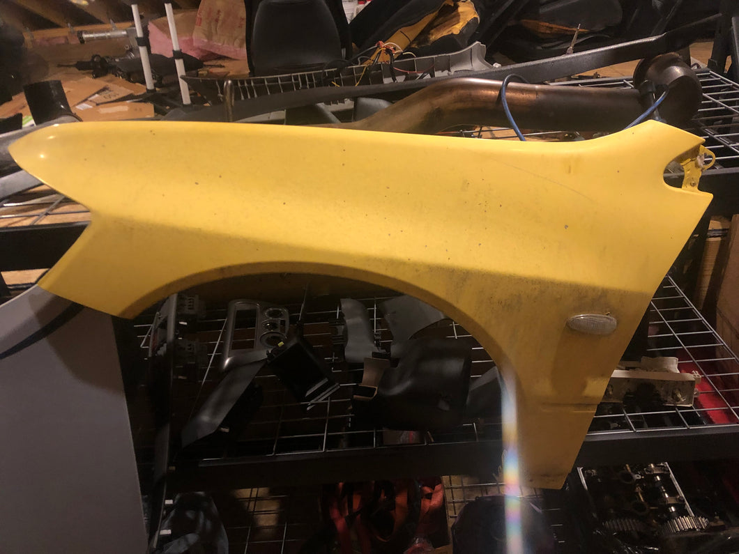 Yellow driver side fender