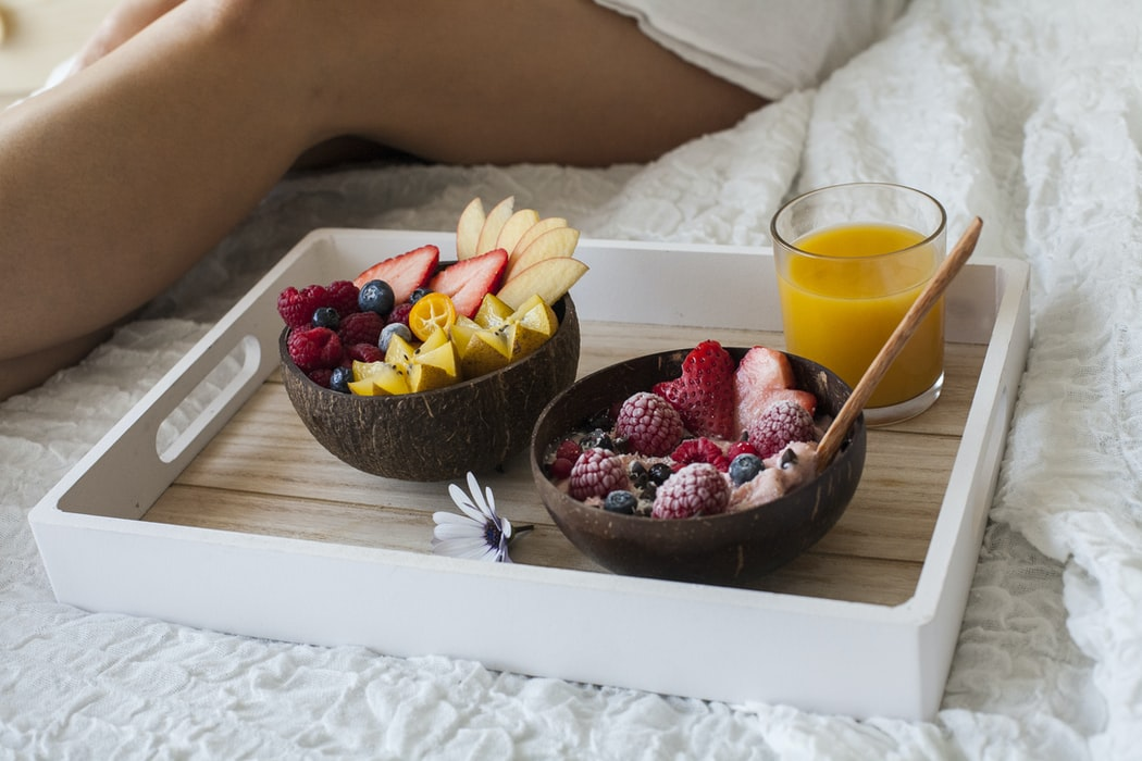 Serve breakfast in bed, with a little note tucked under the plate
