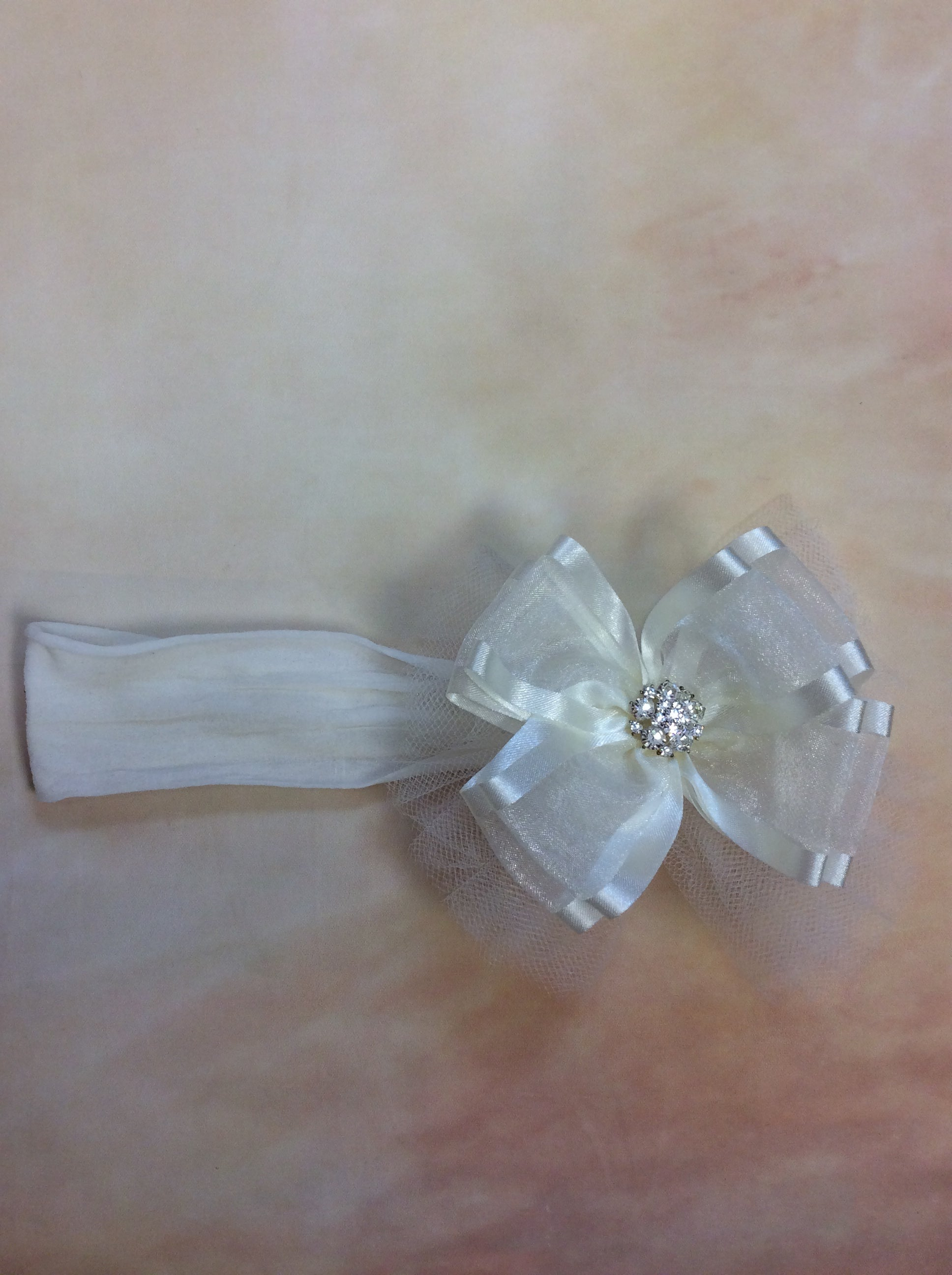 BWISO1 Ivory satin & organza headband with crystal center stone