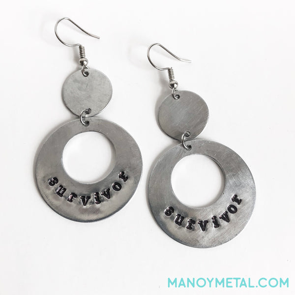 survivor::: {circle dangle earrings)