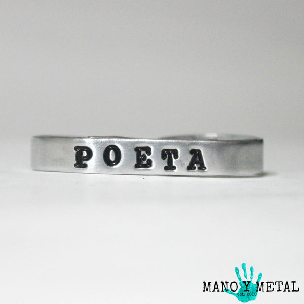 POETA  {bar double-finger ring}