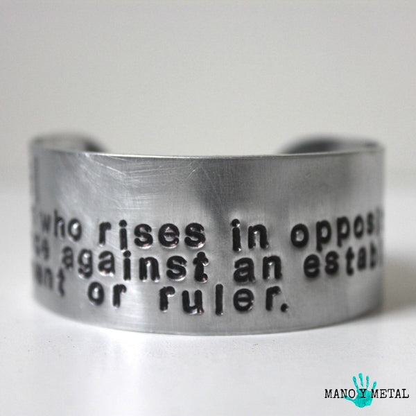 reb·el: a person who rises in opposition or armed resistance against an established government or ruler. {bracelet}