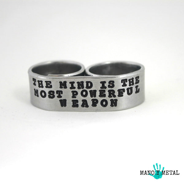 The mind is the most powerful weapon::: {double-finger ring}