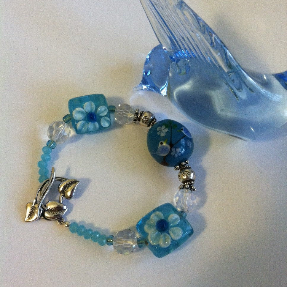 Blue and White Flowered Bracelet Pastel Blue Lamp Work Glass Chinese Crystal and Sterling Silver Floral Bracelet With Birds and Leaf Clasp