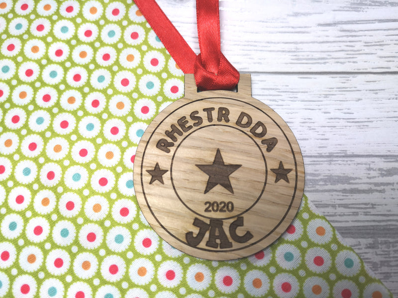 Personalised Welsh Christmas Good behaviour Nice list award oak medal gift