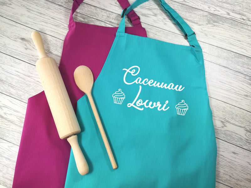 Personalised adult Welsh Cacennau apron in raspberry or duck egg blue with choice of coloured detail