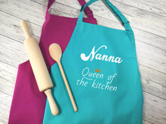 Personalised adults Queen of the kitchen apron in raspberry or duck egg blue