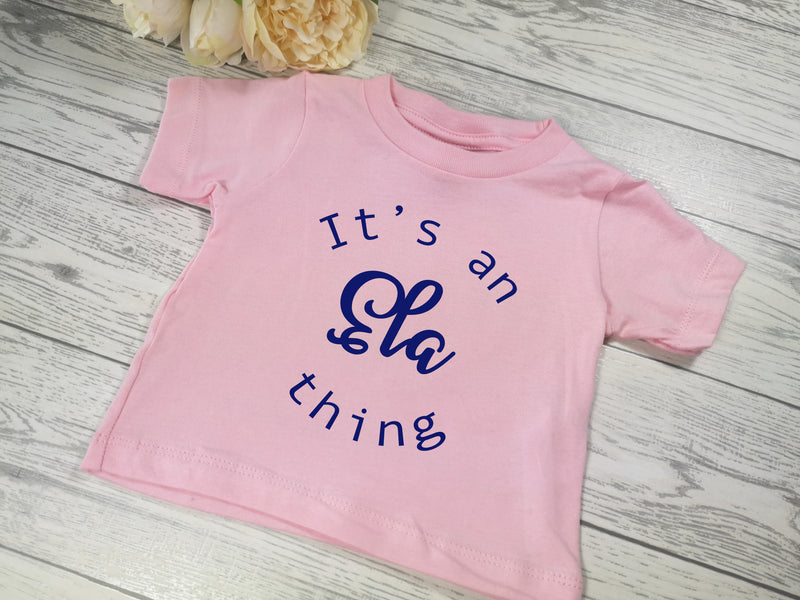 Personalised Baby pink  Baby t-shirt with It's a NAME thing detail