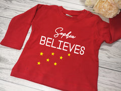 Personalised Baby Christmas RED t-shirt Name believes detail in a choice of colours