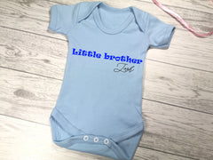 Personalised Baby blue Little Brother Baby vest suit with name detail in a choice of colours