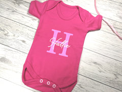 Personalised fuchsia pink Baby vest suit with letter and name detail