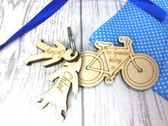 Personalised Wooden bike with boy and girl figures Key ring This Dad belongs to..