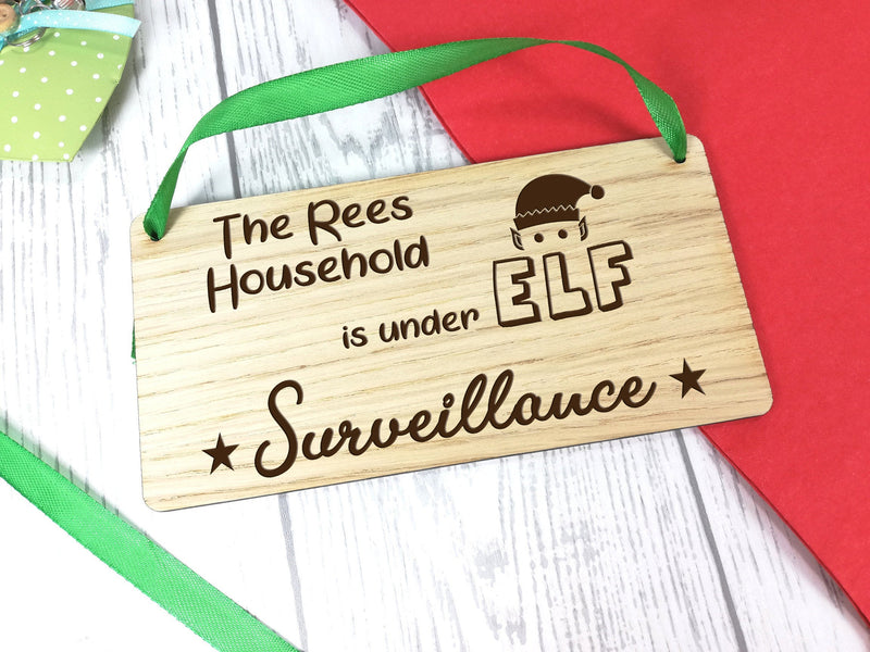 Personalised Engraved oak veneer 20cm hanging Christmas sign Elf surveillance Any Surname