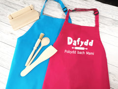 Personalised children's Welsh Pobydd bach apron in pink or blue
