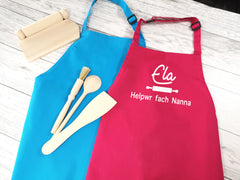 Personalised children's Welsh Helpwr bach / fach apron in pink or blue