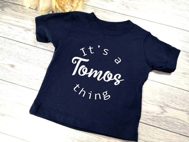 Personalised NAVY Baby t-shirt with It's a NAME thing detail