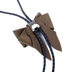 Reverse (back) view of bolo tie necklace showing silver-plated metal clip.