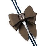 This statement piece combines our Marrs Makers signature leather bow with the swagger of a bolo tie; the functionality of a necklace and the drama of a choker.   Smooth finish, solid calf leather bow with Marrs Makers embossed horse mascot. Bolo slide clip on reverse adjusts braided leather cord length, then fastens in place. Nickel plated bolo tips.