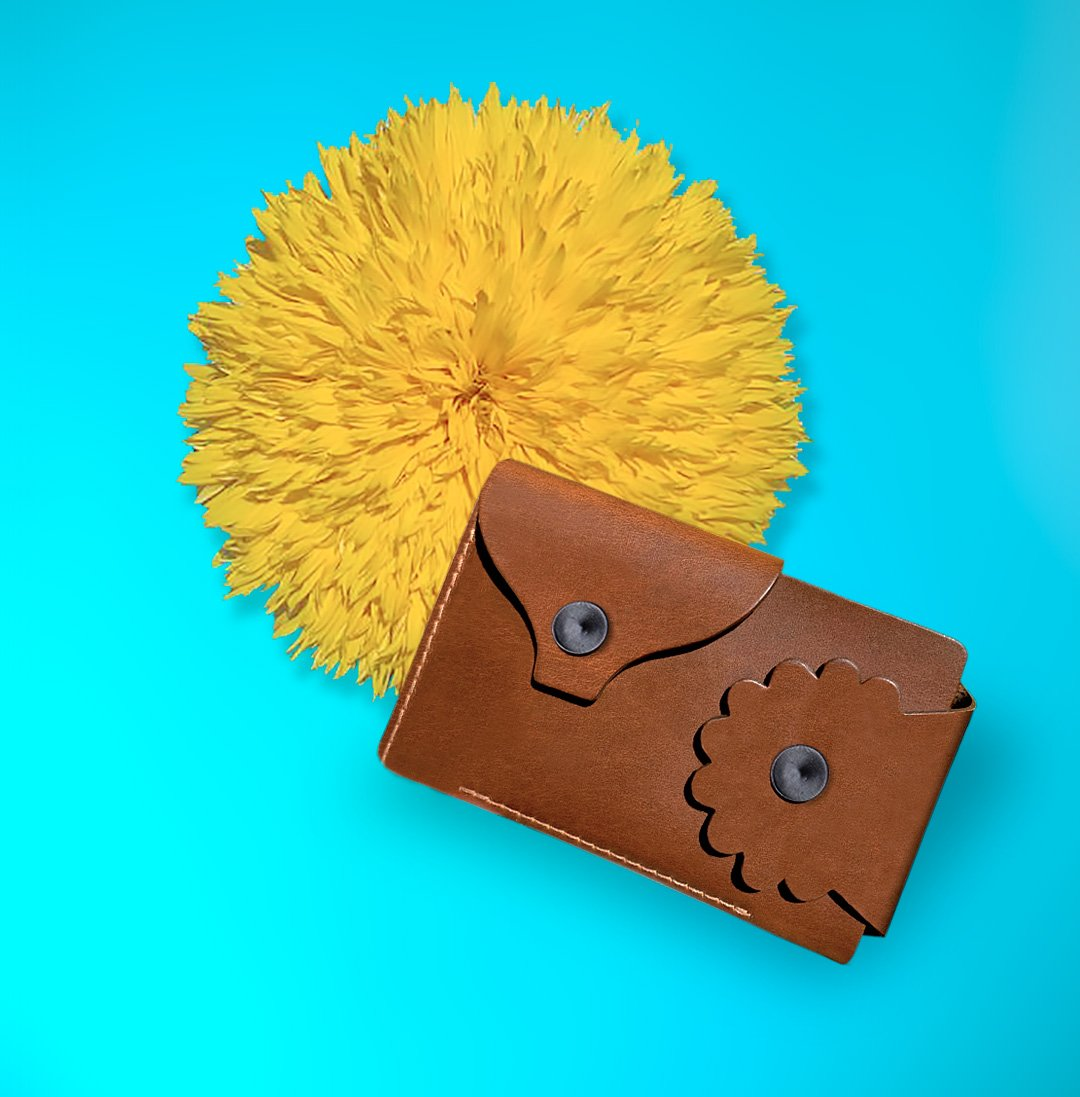 Marrs Makers Cognac Brown Leather Wallet. Bright turquoise background color with large sunflower in this product shot.