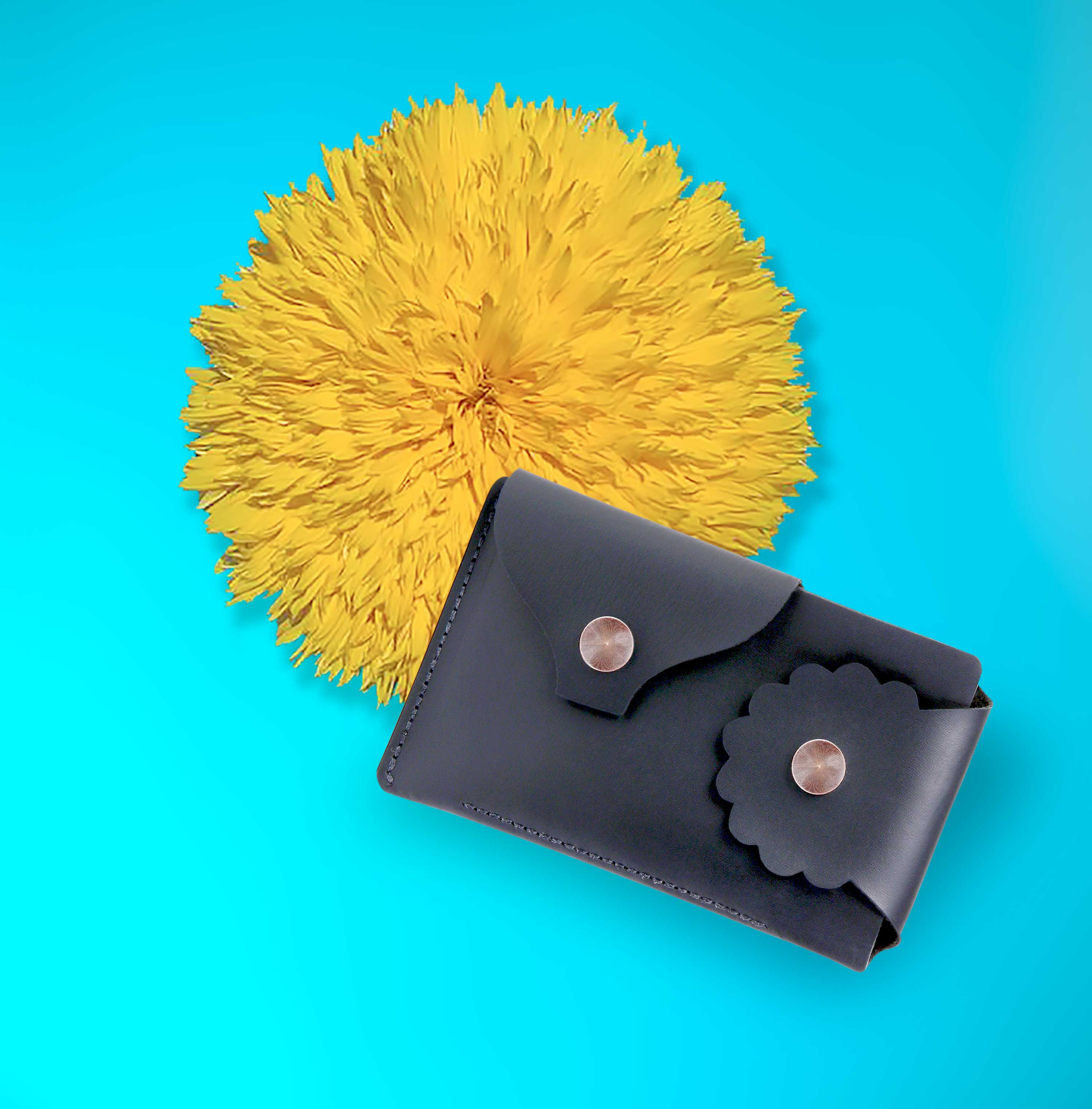 Marrs Makers Matte Black Leather Wallet. Bright turquoise background color with large sunflower in this product shot.