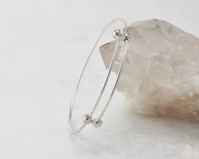 adjustable bangle bracelet shown on crystal rock