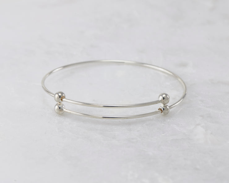 bangle bracelet silver adjustable open on marble