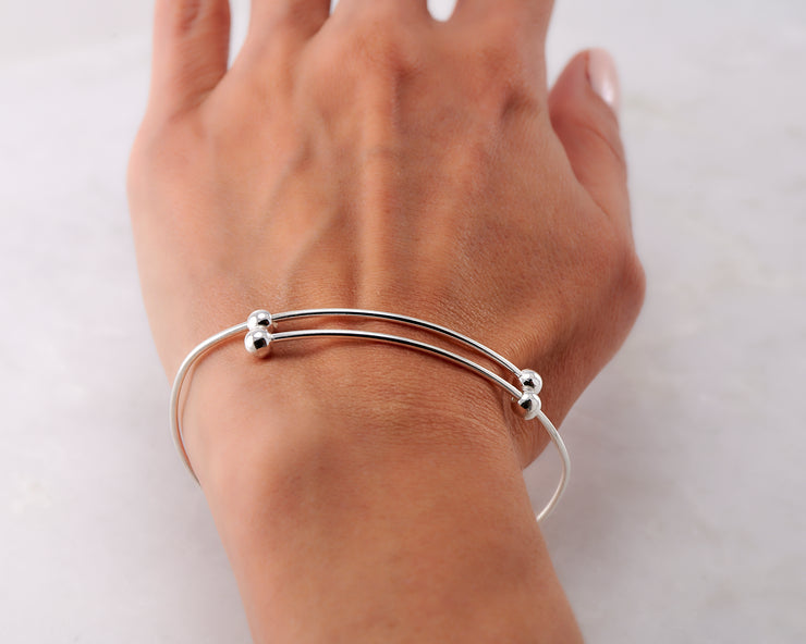 Woman wearing silver adjustable bangle