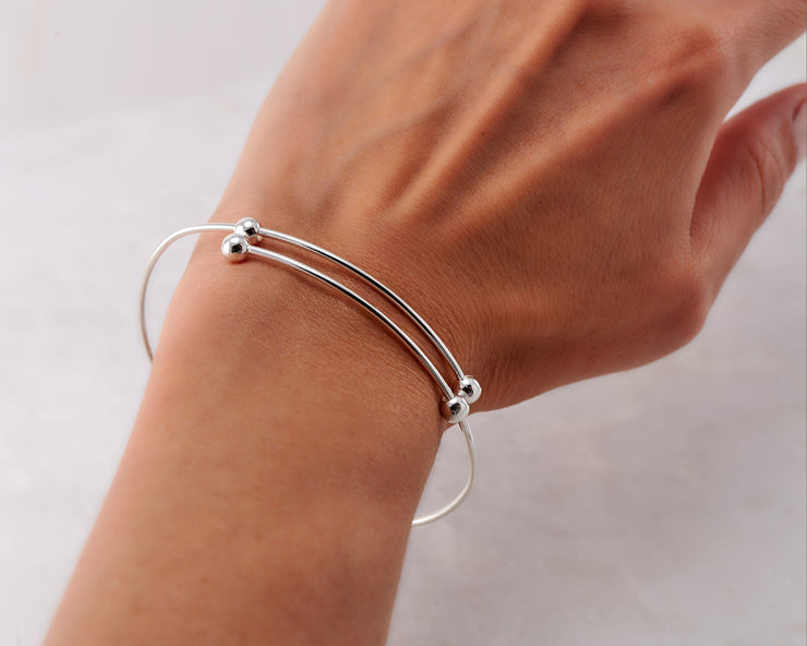 Woman wearing silver adjustable bracelet