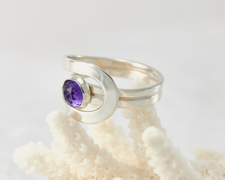 Silver amethyst ring on coral