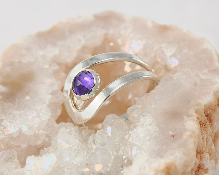 amethyst wrap ring on crystal rock