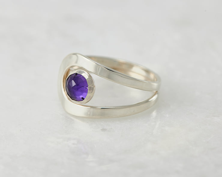 wrap amethyst ring on white marble