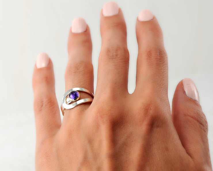 Woman wearing wrap amethyst ring