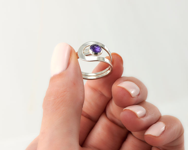 Woman holding amethyst silver ring