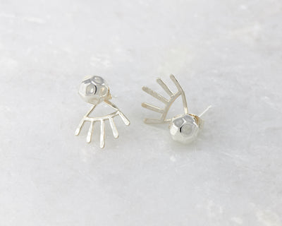 silver hammered ear jacket stud earrings on white marble