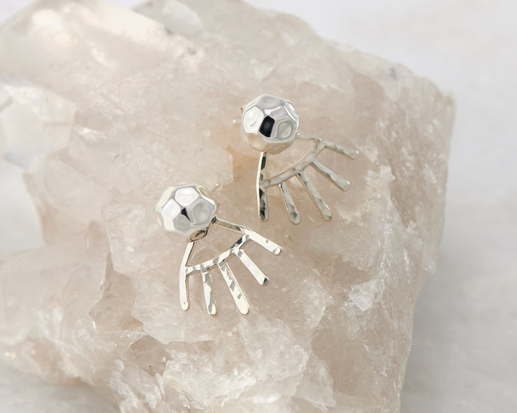 Silver dangle hammered ear jacket stud earrings on white rock