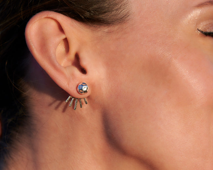 woman wearing silver ear jacket stud earrings