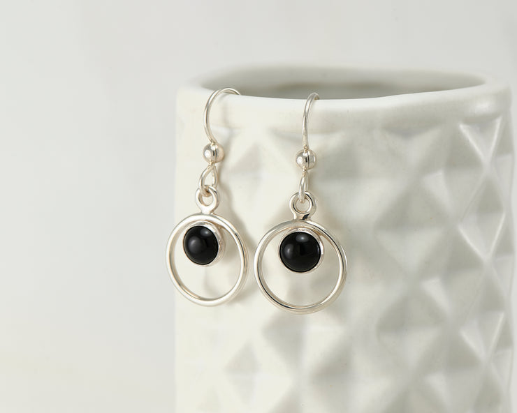 Silver black onyx earrings on geometric vase