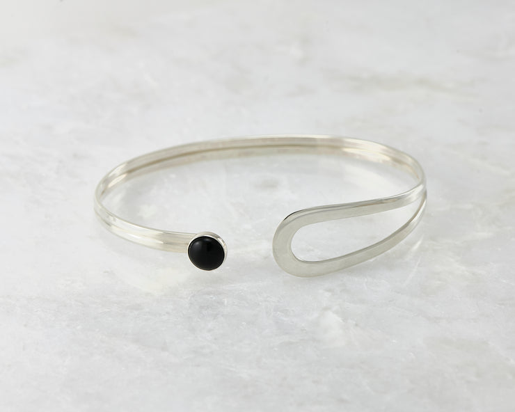 latch style black onyx silver bracelet open on marble