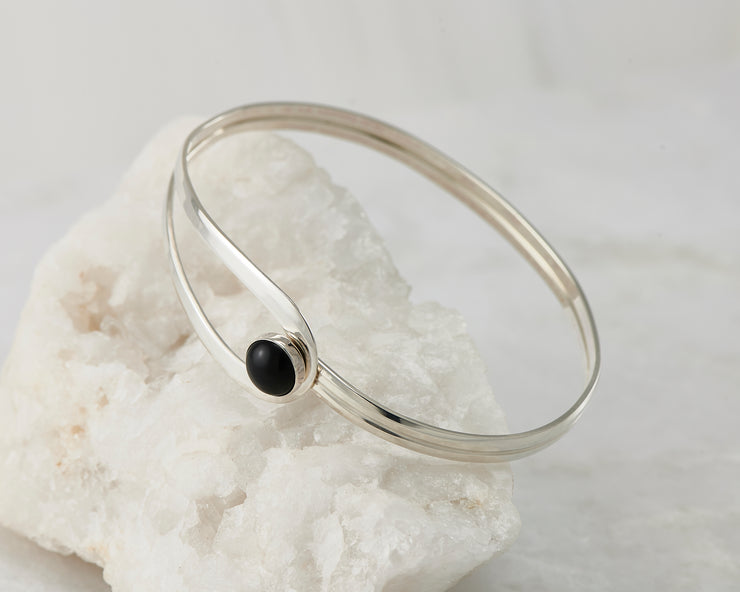 Silver black onyx Bracelet on white rock