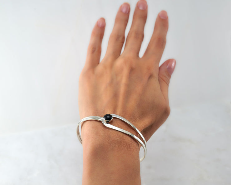 Woman wearing black onyx latch bracelet