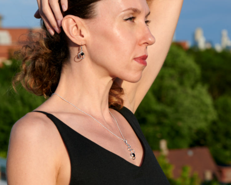 woman wearing black onyx necklace and matching black onyx earrings