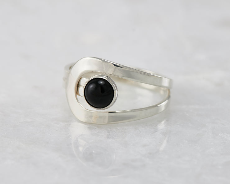 wrap black onyx ring on white marble