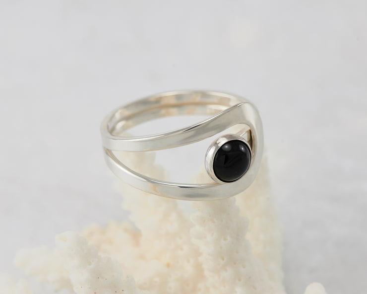 Silver black onyx ring on coral