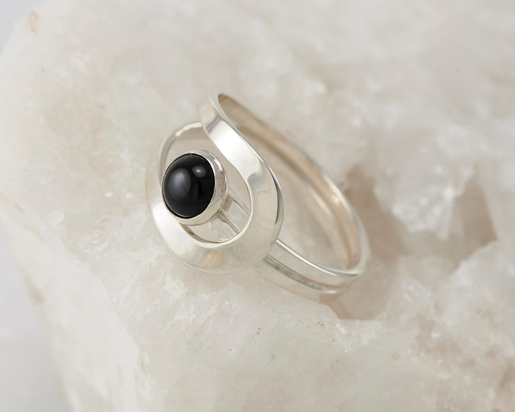 Silver black onyx wrap ring on white rock