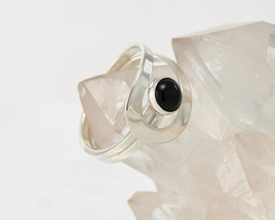 Black Onyx wrap ring on crystal rock