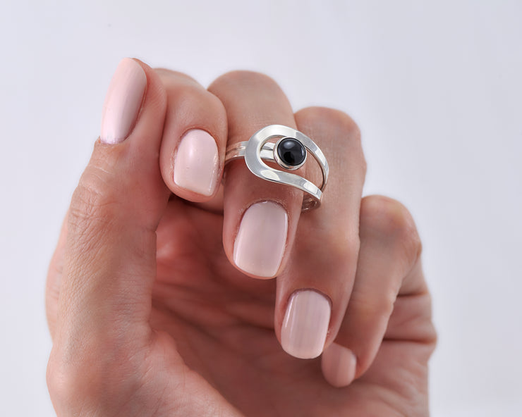 Woman holding black onyx silver ring