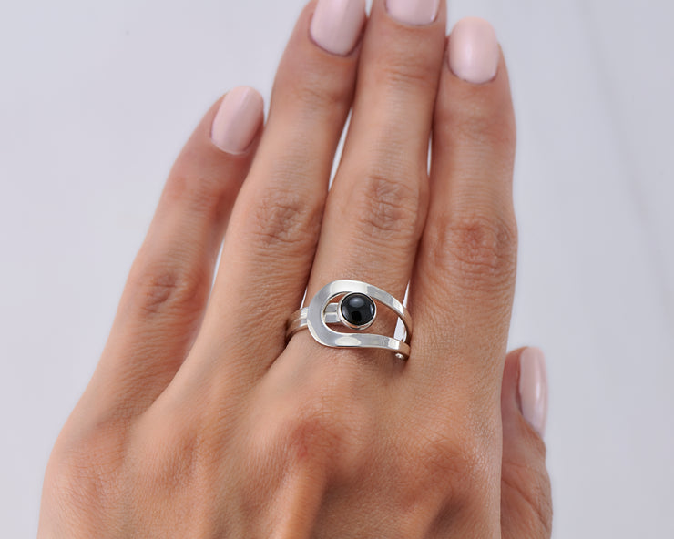 Woman wearing wrap black onyx ring