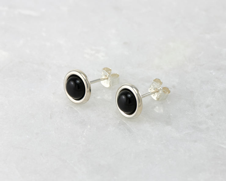 silver black onyx stud earrings on white marble
